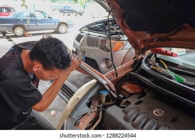 Muadzam Shah, Malaysia - January 10h, 2018 : Mechanic repairing an engine in a garage.