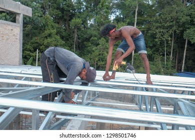 Muadzam Shah, Malaysia - January 28th, 2019 : Construction workers installing metal roof trusses at the construction site.