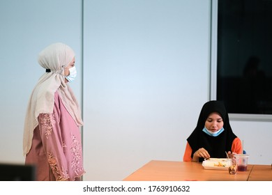 Muadzam Shah, Malaysia - June 25th, 2020 : Student  eating food in the classroom. Social distancing. Concept protection of corona virus or covid-19.