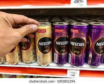 Muadzam Shah, Malaysia - May 17th,  2018: A man holding the Nescafe can in a supermarket