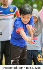 Muadzam Shah, Malaysia -   September 16th, 2020 : People playing Malay traditional games called  Getah Atas Para or  rubber band game  at the field during Malaysia Day