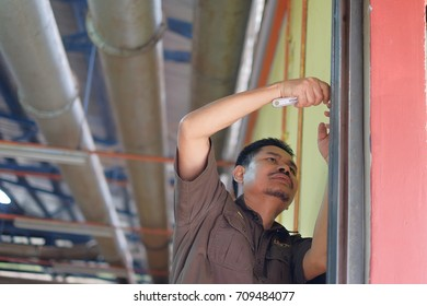 Muadzam Shah, Malaysia - September 5th, 2017 :  The  contractor is making reparation of rolling shutter in Kolej Vokasional Muadzam Shah, Malaysia