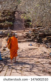 Muang Champassak, Laos - Feb 2016: Buddhist monk walking up the stairs at Wat Phou temple, Laos