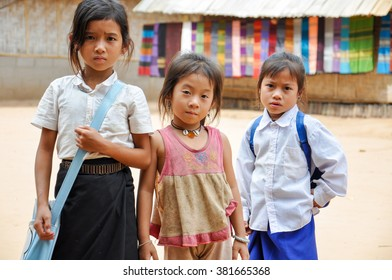 MUANG Ngoi ,LAOS-OCTOBER 27, 2011: Students come to receive visits by tourists out of curiosity , Muang Ngoi , Laos.