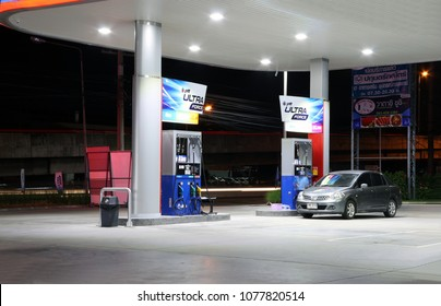 Muang, Pathumthani, Thailand Apr 26, 2018: Gas dispenser of PTT gas station in Thailand on dark night. (PTT : Petroleum Authority of Thailand) PTT is a Thai state owned SET-listed oil and gas company.