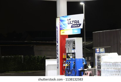 Muang, Pathumthani, Thailand July 10, 2018: Gas dispenser of PTT gas station in Thailand on dark night. (PTT: Petroleum Authority of Thailand) PTT is a Thai state owned SET-listed oil and gas company.