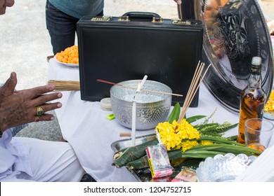 MUANG, SAMUTPRAKARN- SEPTEMBER 6 : Unidentified man is in worship the shrine of city pillar on September 6, 2018 at The shrine of city pillar, Muang,Samutprakarn, Thailand.