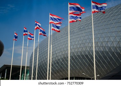 Muang Thong Thani,Thailand - Oct 28, 2017;Flag of Thailand in front of modern architecture building of Exhibition and Convention Public Center,Thailand.