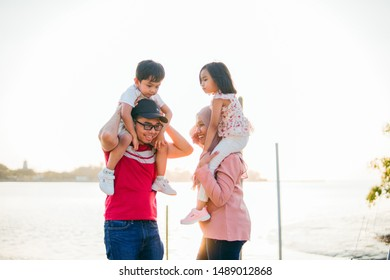 Muar, Johor, Malaysia - February 8, 2019 - A muslim family enjoying quality time together with their son and daughter