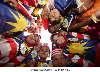 Muar, Malaysia - August 31,2018. A kids take picture group  together with malaysia flag in muar. Kids with dress malaysia flag