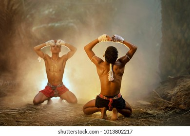 Muay thai, Thai Boxer training in sunset background,Thai boxer culture,Thailand