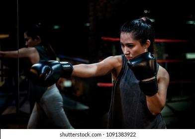 Muay Thai Training Girl with Film Grain and Underexposure