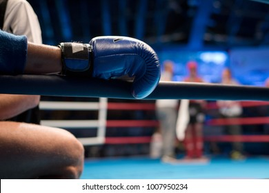 Muaythai boxer hand on the ring rope during the break