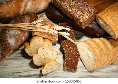 Much bread on wooden board