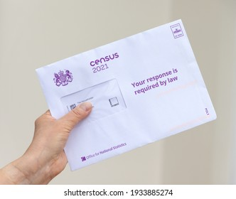 Much Hadham, Hertfordshire, UK. March 11th 2021. Hand holding an envelope containing a leaflet and household access code to complete the 2021 UK Census online.