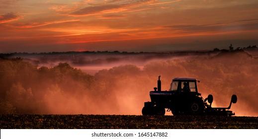 Much Hadham, Hertfordshire. UK. September 24th 2003. Tractor preparing land at sunset.