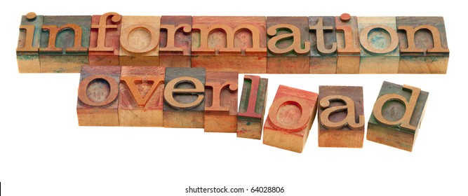 too much information or information overload concept - words in vintage wooden letterpress type isolated on white
