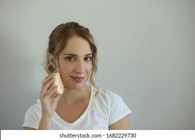 So much magic in a small sponge. Portrait of beauty woman. Holding sponge. Space for copy.