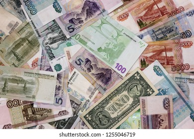 Much money. Banknotes of different countries are a bunch of alternately. Rubles, dollar, Euro, yuan. The concept of international business and tourism.