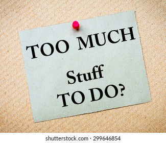 Too Much Stuff to Do? Message written on recycled paper note pinned on cork board. Motivational concept Image