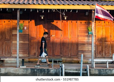Mucr the war, Thailand - December 18, 2016: Asian men were returning from shopping in the morning.