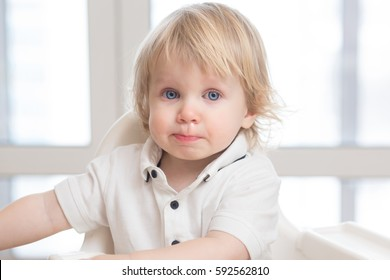 Mucus flowing from nose of little baby boy. child has a runny nose with clear snot, SARS