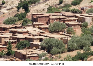 Mud brick houses in the desert area on the way to Merzouga from Marrakech in Morocco.