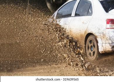 Mud debris splash from a rally car ( Focus at mud debis)