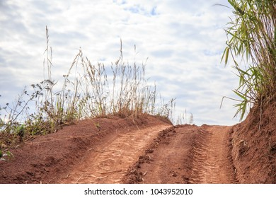 mud or dirty road on the mountain hill with sky clouds of country side.