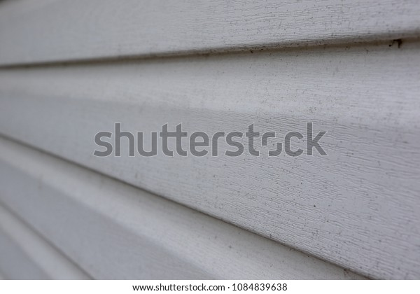 Mud and dirty spot covered plastic white farmhouse siding texture