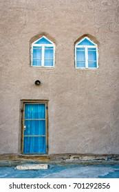 Mud facade with door and windows in Khiva old town, Uzbekistan