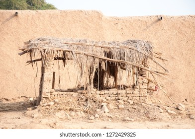 Mud house and straw hut in the desert