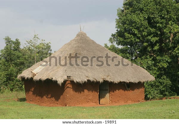 Mud House with Thatched Roof in Africa