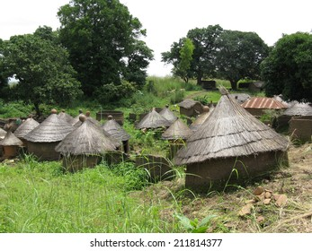 Mud huts with grass roofs are typical architecture of tribal cultures on the grassy savannah of Africa