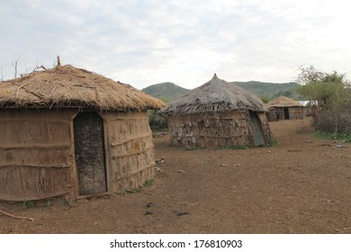 Mud huts with thatch roofs are home to the Maasai tribe iin the Great Rift Valley of Tanzania, Africa