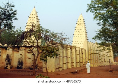 Mud mosque at Bobo Dioulasso with muslim man
