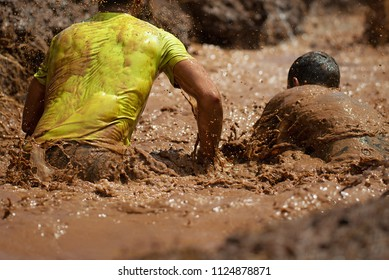 Mud race runners,during extreme obstacle races