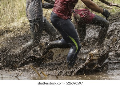 Mud race runners,man running in mud