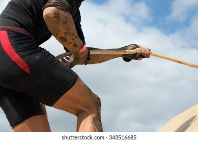 Mud race runners.Racing- overcome barriers using ropes