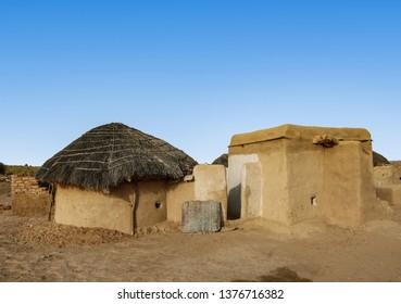 Mud and straw huts in the Sahara desert