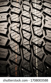 mud tire protector for off-road vehicles. textural auto background, vertical photo
