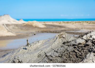 Mud volcano erupting mud, Gobustan park, Azerbaijan