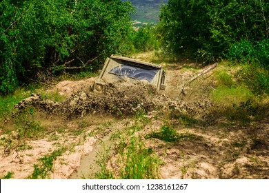 Mud and water splash in off-road racing. Mudding is off-roading through an area of wet mud or clay. Tracks on a muddy field. Track on mud. 4x4 Off-road suv car. Offroad car. Safari