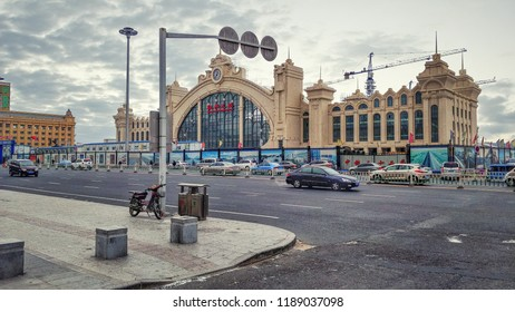 Mudanjiang, Heilongjiang province, China-February 10, 2018: New railway station building is under the construction. It has central semi oval part with a clock and side wings. It is separated by fence