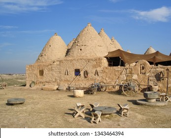 """Mudbrick house in Harran, Turkey. Traditional mudbrick """"beehive"""" house with cone-shaped roofs in Harran - ancient town in South-Eastern region of Turkey"""