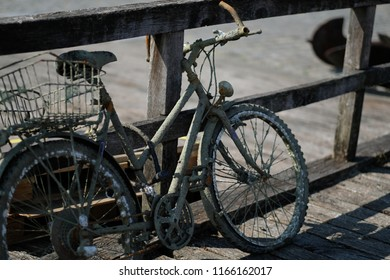 A muddy bike pulled out of the water