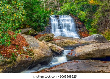 Muddy creek waterfall in the Appalachian mountains during Autumn with Fall colors