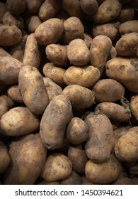 Muddy, dirty potatoes have started sprouting in storage