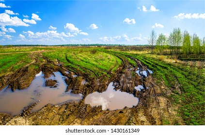 Muddy dirty rural road after rain. Country road after rain. Dirty road after rain. Off road after rain landscape