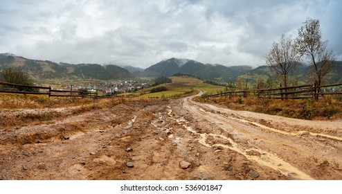 Muddy ground after rain in Carpathian mountains. Extreme path rural dirt road in the hills